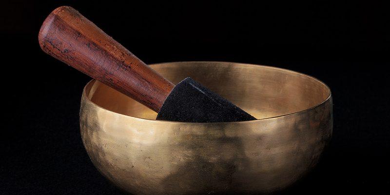 tibetan bell on black backgorund